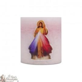 Bougie parfumée et colorée dans la masse au Christ Miséricordieux