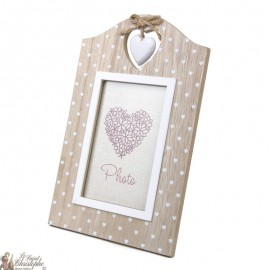 Photo frame with wooden heart motifs