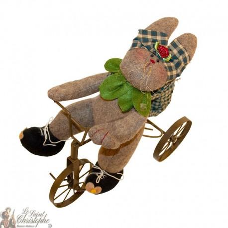 Lapin décoratif à vélo