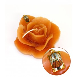 Orange flower candle with Little Jesus of Prague medal