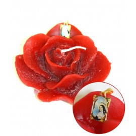 Candle in the shape of a rose with St. Rita's medal